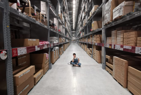 woman sitting on ground in warehouse