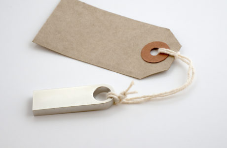 usb drive attached to a paper tag
