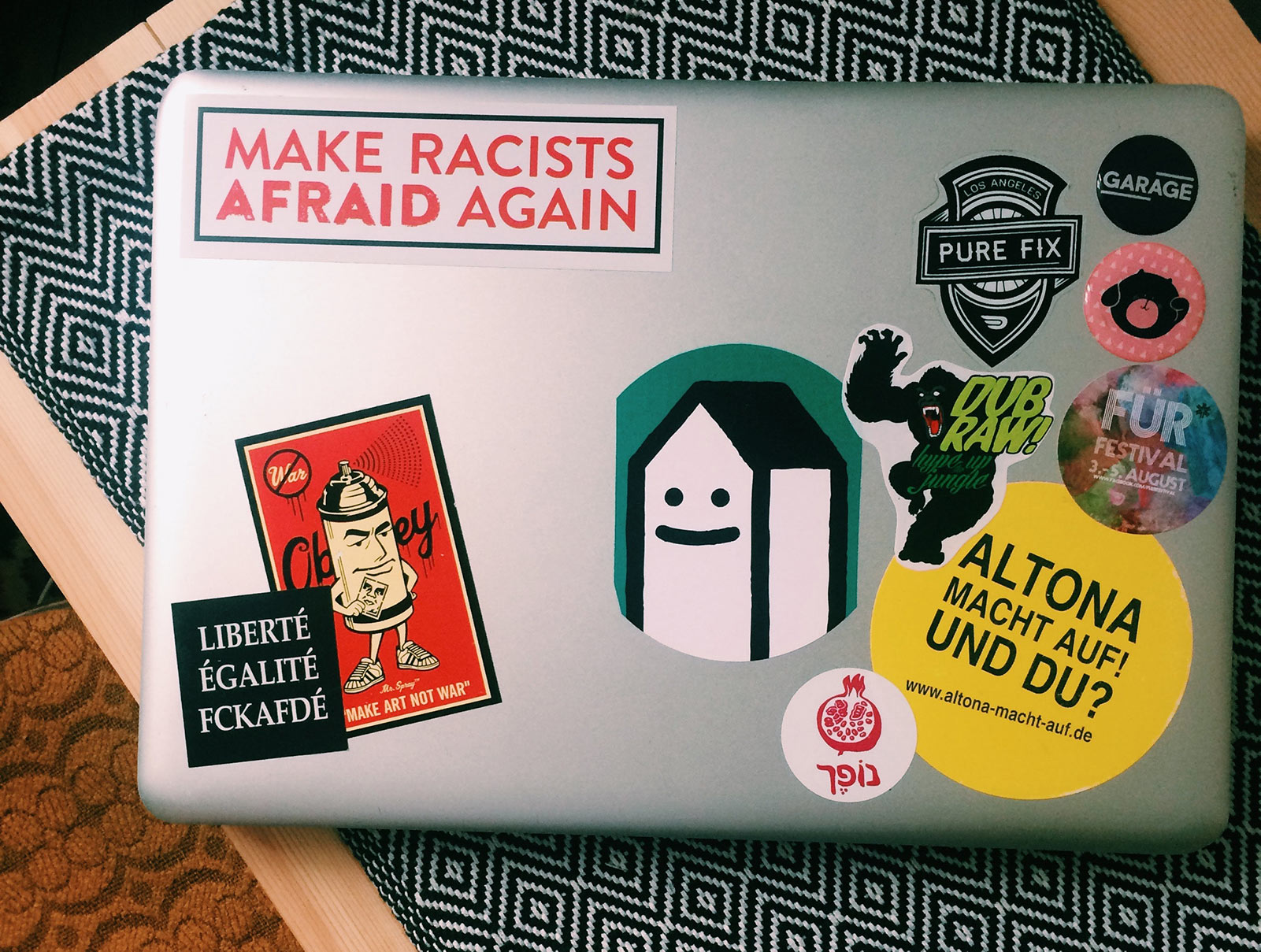 a laptop with lots of stickers on it