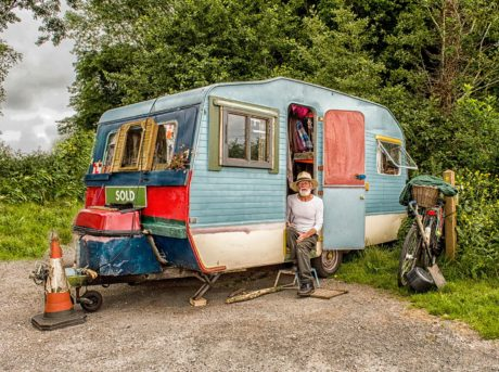 man sitting in trailer home