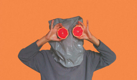 person with bag over head and grapefruits for eyes