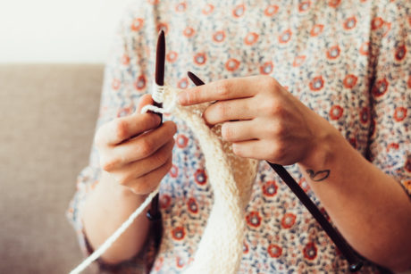 person holding crochet