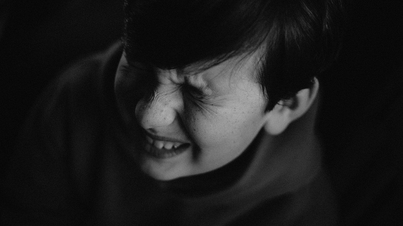 boy grimacing in pain